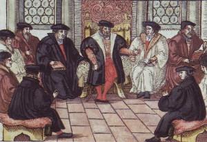 Kolorierter Holzschnitt (1557) der Leipziger Disputation zwischen Johannes Eck und Martin Luther (1519). Quelle: wikimedia commons, Torsten Schleese).